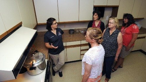 Shannon Carter, left, demonstrates proper use of a pressure canner during one of 10 home food preservation classes she offered this summer. (photo: Ken Chamberlain, CFAES)