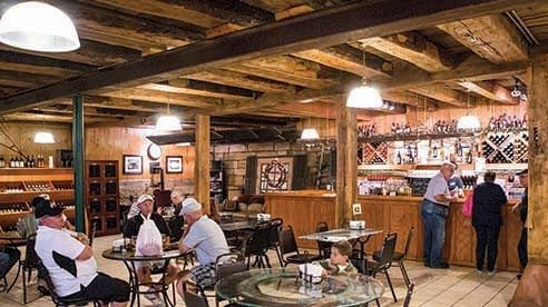 The winery at Maize Valley features rough hewn timber and a cozy setting for sipping or sampling.