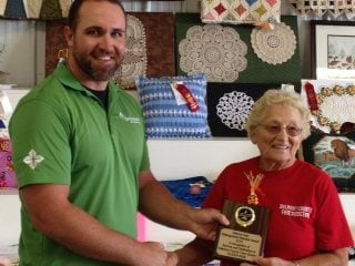 Pictured is President Andy Barricklow presenting the Glenna Cain Award to Eileen Wise at the Belmont County Fair.