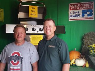 Grill Giveaway Winner pictured with County Vice President Jason Feldner