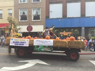 Wagon with Farm Bureau banner in the 2015 Barnesville Pumpkin Festival Parade