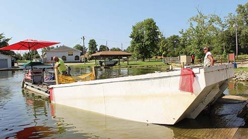 Choctaw Lake property owners paid for dredging equipment that is removing bottom sediment, which is rich in phosphorus, from shallow areas of the lake.