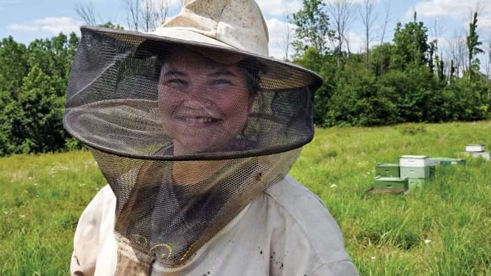 OFB_beekeeper_2113: Bethany Carlson, 20, has been keeping bees and processing honey since high school  on her apiary in  Edgerton, Ohio,  Thursday, June 30, 2016.  (Photo by Peggy Turbett)