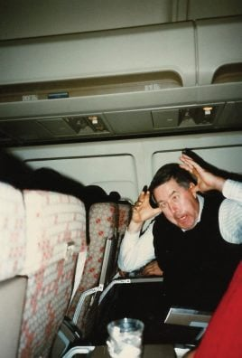 Kenny Walter making goofy face on airplane