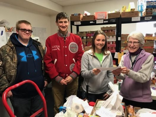 Shelby FFA shares donation with the Shelby F.I.S.H. food pantry.