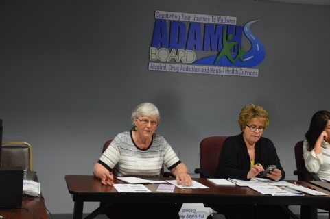 Tuscarawas County Farm Bureau member Rita Lahmers (left) and Organization Director Michele Specht discuss the drug epidemic at a policy development meeting in May.