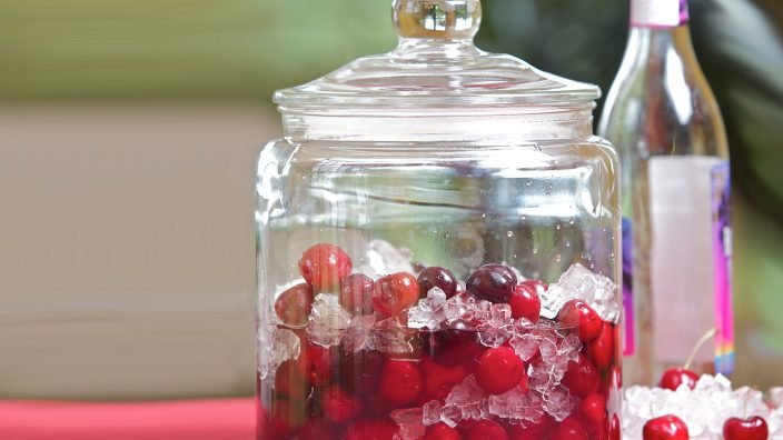 Delicious cherries in a jar with ice
