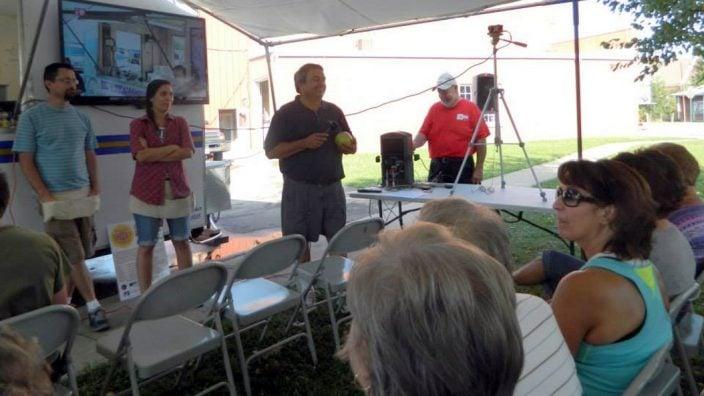 Farm to Plate volunteers introduce Farmers' Market vendors.