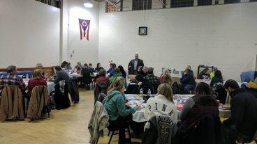 Volunteers listen to Senior Director, Membership, Paul Lyons, speak about consultative sales.