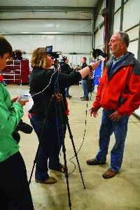 Hardin County member Bill Kellogg speaks with reporters at his farm during media day at the Blanchard River Demonstration Farms.