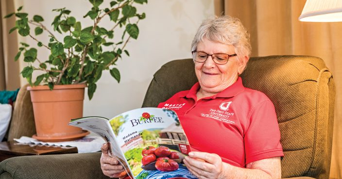 Madison County Farm Bureau member and Pickaway County master gardener Peggy Riley peruses a gardening catalog as she makes plans for spring plantings, a favorite winter pastime.