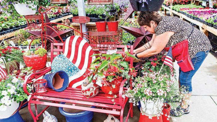Sue Wolf, owner of Wolf's Blooms Berries photographed Thursday, May 25, 2017 in Bowling Green, Ohio works on organizing some Memorial Day arrangements at the greenhouse. (© James D. DeCamp | http://JamesDeCamp.com | 614-367-6366)