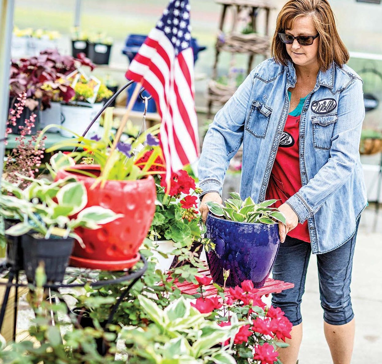 Kim Ringler, Plant Production, Wolf's Blooms Berries photographed Thursday, May 25, 2017 in Bowling Green, Ohio works on organizing some Memorial Day arrangements at the greenhouse. (© James D. DeCamp | http://JamesDeCamp.com | 614-367-6366)
