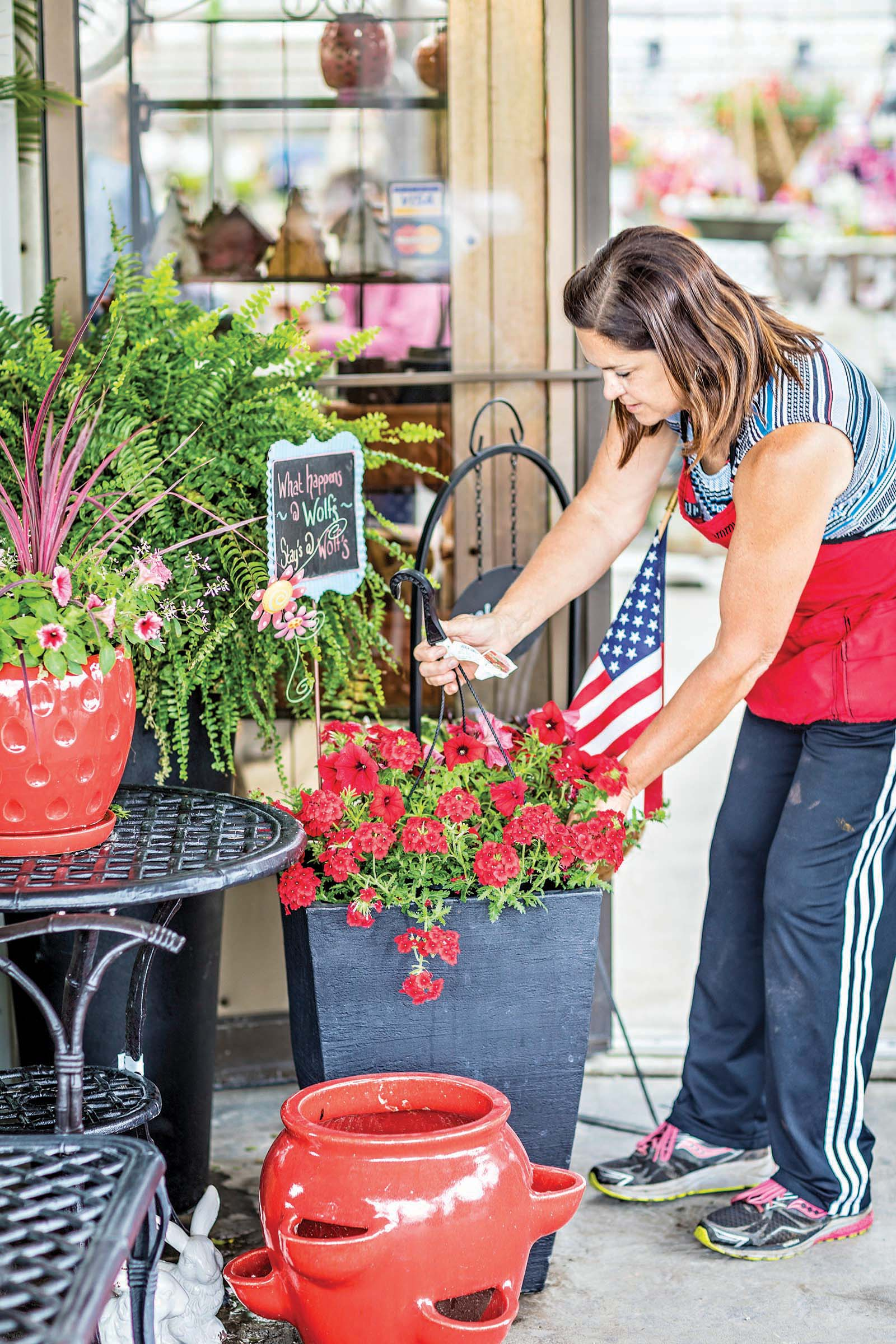 Tammy Faykosh, Head Gardener, Wolf's Blooms Berries photographed Thursday, May 25, 2017 in Bowling Green, Ohio works on organizing some Memorial Day arrangements at the greenhouse. (© James D. DeCamp | http://JamesDeCamp.com | 614-367-6366)