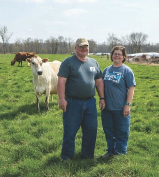 Long-time dairy farmers Eric and Barb Grim on their farm in New London.