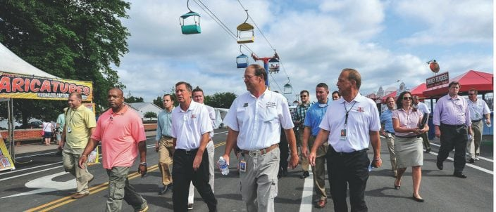 Strickler tours the fair with Gov. John R. Kasich and Ohio Department of Agriculture Director David T. Daniels.