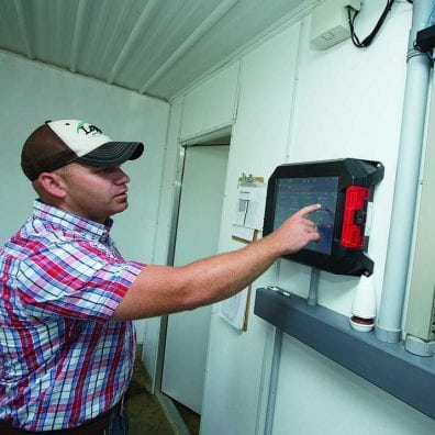 Evan Jackson can adjust the hog barn controls from the office or with his smartphone.
