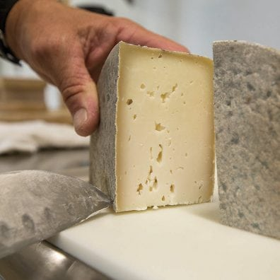 After aging for a minimum of 60 days in the cheese cave, Ruffwing Farms aged Moncaito cheese is ready to eat.