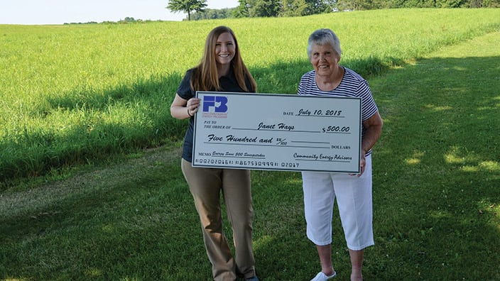 Sweepstakes winner Janet Hays, with Sarah Margelowsky, manager of operations for Farm Bureau's energy program partner