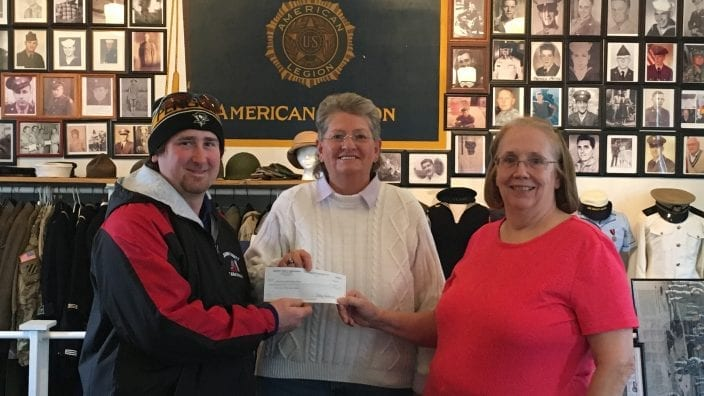 Devin Cain, Belmont County Farm Bureau trustee, presented a check to Cheryl Skinner and Kim Kuthy, both with the Veterans Museum.