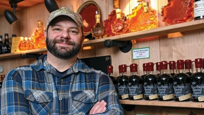 OFB_Bissell_1431: Nate Bissell,  sixth-generation owner of Bissell Maple Farm,  has expanded the Sugar Chalet line of maple products sold in the Bissell Maple Farm retail shop in Jefferson, Ohio,  Wednesday, Feb. 27, 2019. (Photo by Peggy Turbett for the Ohio Farm Bureau.)