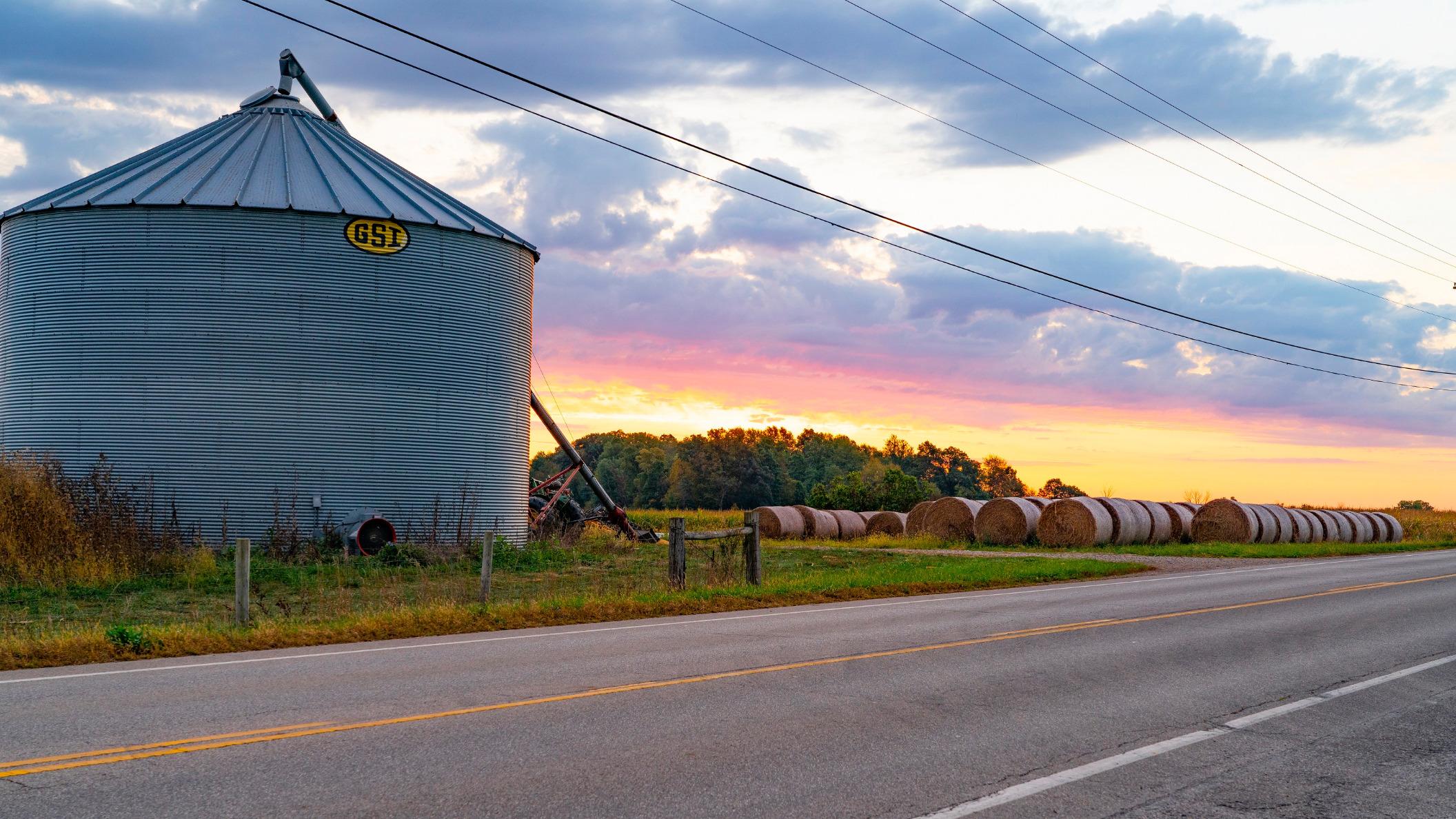 Grain bin at sunset